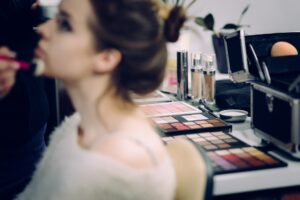 Woman getting Make up done